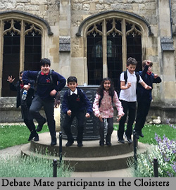Pupils from DebateMate in the cloisters at Christ Church
