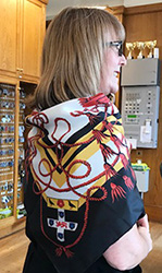 Lodge Manager Mandy Roche wearing a 40th Anniversary silk scarf