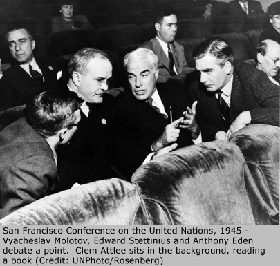 San Francisco Conference on the United Nations, 1945 - Vyacheslav Molotov, Edward Stettinius and Anthony Eden debate a point.  Clem Attlee sits in the background, reading a book (Credit: UNPhoto/Rosenberg)