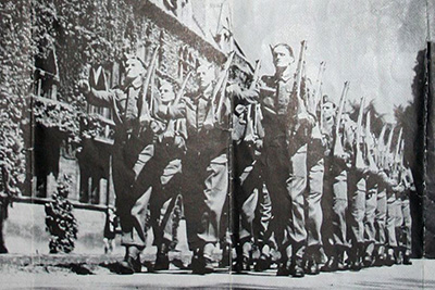 Troops on parade by Meadows building