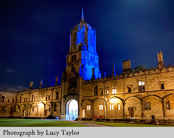 Tom Tower lit up blue for the NHS. Photograph by Lucy Taylor