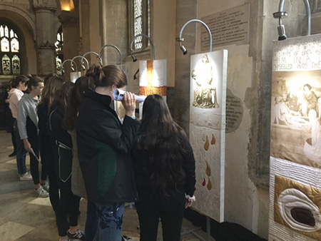 Students studying am installation in the north transept