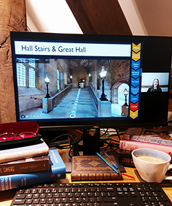 A computer screen with the virtual tour playing on it