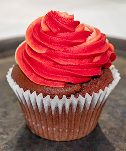 A cupcake with bright red icing