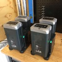 The four Allett cylinder mower batteries on charge