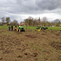 Clearing turf clods away.