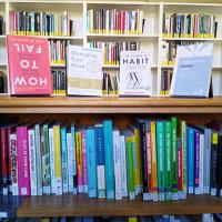 Image of a number of books in the Christ Church Library featuring some about Mental Health