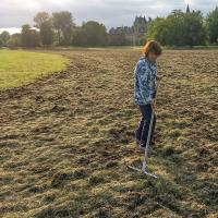Catriona Bass raking out some areas where the hay was too thick. (Photo © Kevan Martin)