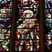 A large stained glass window depicting St Michael