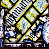 Detail from a stained glass window in Hall showing the White Rabbit