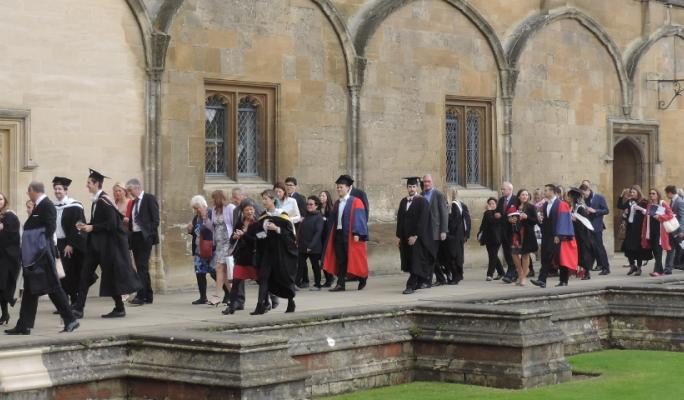 New graduates and guests in Tom Quad