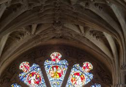 Deatil of a stained glass window and ceiling architecture in the Cathedral
