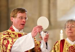 Edmund Newey leads a communion service