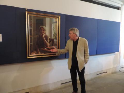 Artist Jason sullivan with his portrait of Prof. Judith Pallot