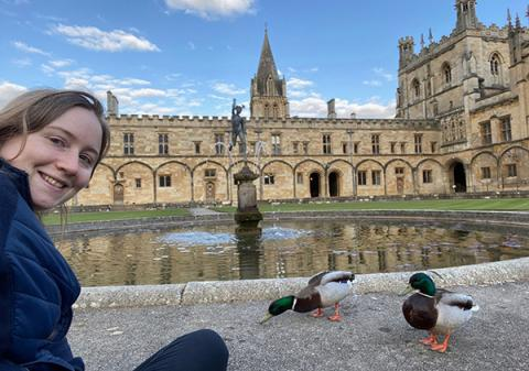 Dr Lucy Taylor with some of Christ Church's resident ducks in Tom Quad