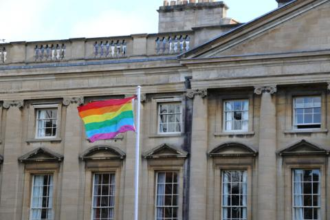 The rainbow flag flying in Peck Quad