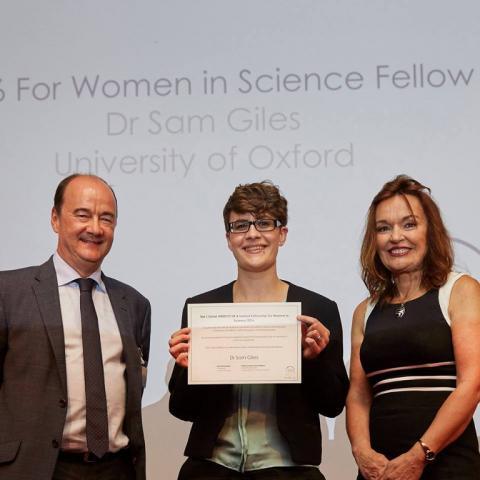 Dr Sam Giles receiving her award