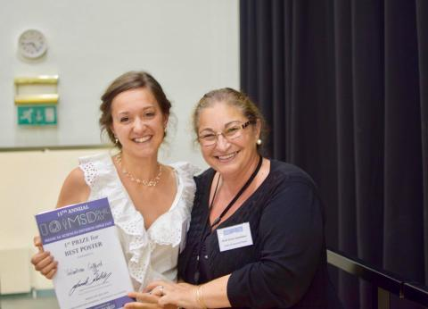 Valentina Gifford being awarded her poster prize