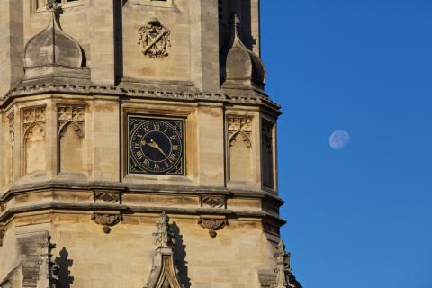 The moon visible beyond Tom Tower