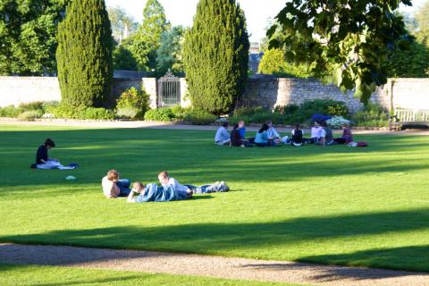 Students relaxing in the Masters Garden