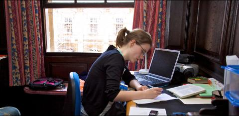 A student studying in her room