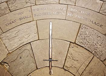 Inscription in the path by the gates to the Memorial Garden